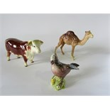 A Beswick model of a Hereford bull with circular printed mark to base, a Beswick model of a standing