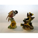 A Beswick model of a Chickadee with impressed number to base 929 and a Beswick group of a pair of