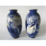 A pair of large early 20th century Royal Doulton blue and white printed vases, one showing a coastal