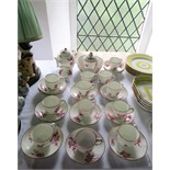 A collection of 19th century French Sevres type teawares with painted pink floral sprigs and