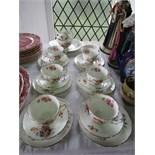 A collection of Coalport Junetime pattern floral teawares comprising: milk jug, sugar bowl, cake