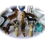 A collection of ceramic animals including a Sylvac buff glazed model of a doleful dog with impressed