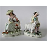 A pair of 19th century Staffordshire figure groups, one of a seated female character feeding a large