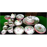 A quantity of French Luneville floral decorated dinner and teawares including an oval meat plate,