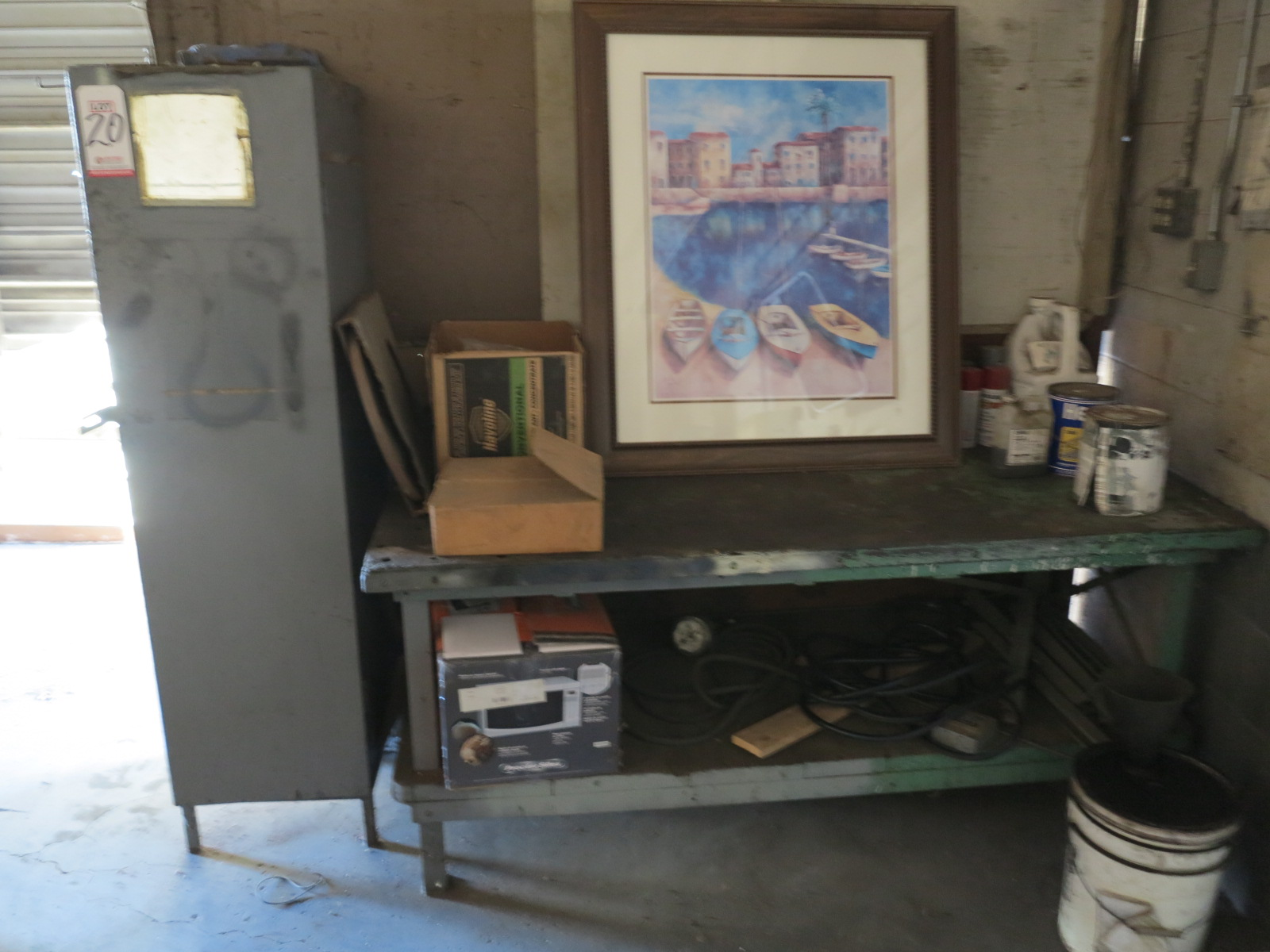Lot 20 - LOT - STEEL AND WOOD WORKBENCH W/ CONTENTS AND CABINET FULL OF MAINTENANCE SUPPLIES