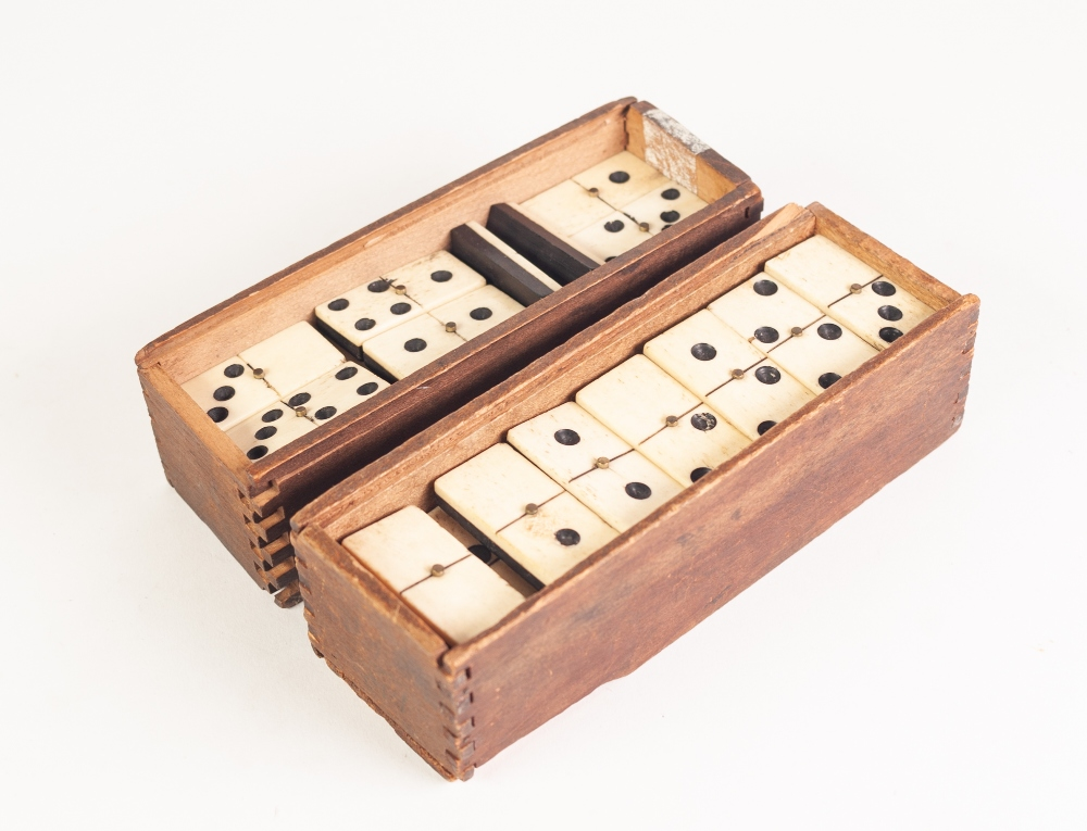 Lot 219 - TWO WOODEN BOXED SETS OF BONE AND EBONY DRAUGHTS