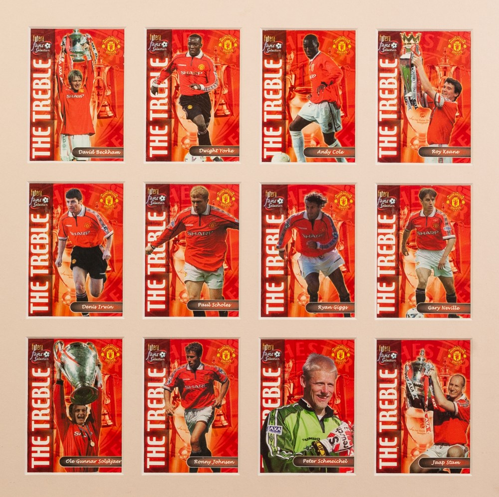 Lot 68 - THREE FRAMED AND GLAZED CARDS OF MANCHESTER UNITED PLAYERS, European Champions 1999, The Treble