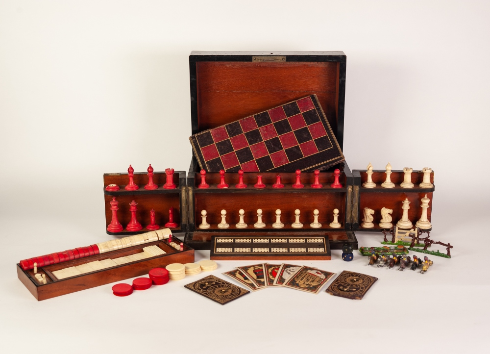 Lot 225 - A VICTORIAN COROMANDEL WOOD GAMES COMPENDIUM with natural and red stained ivory CHESS SET (one piece