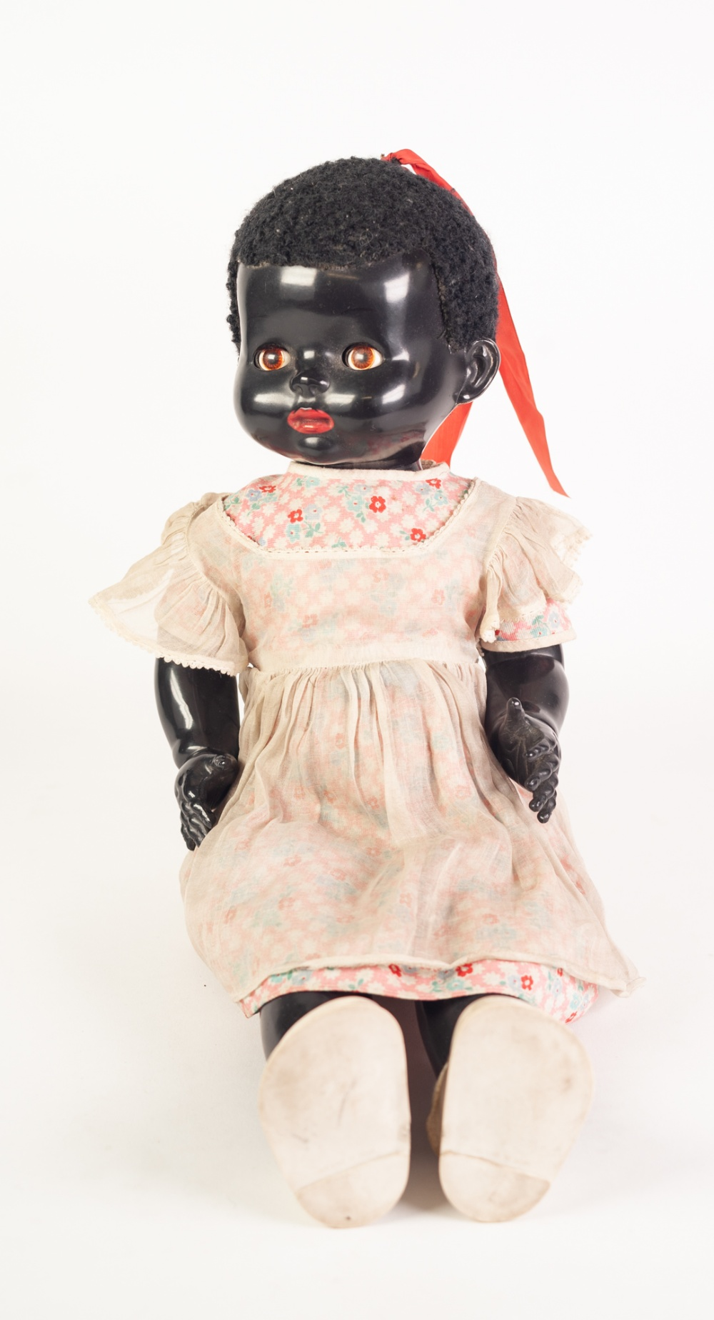 Lot 312 - a 'PEDIGREE' HARD PLASTIC BLACK BABY WALKING DOLL, with fabric wig, brown glass fixed eyes,