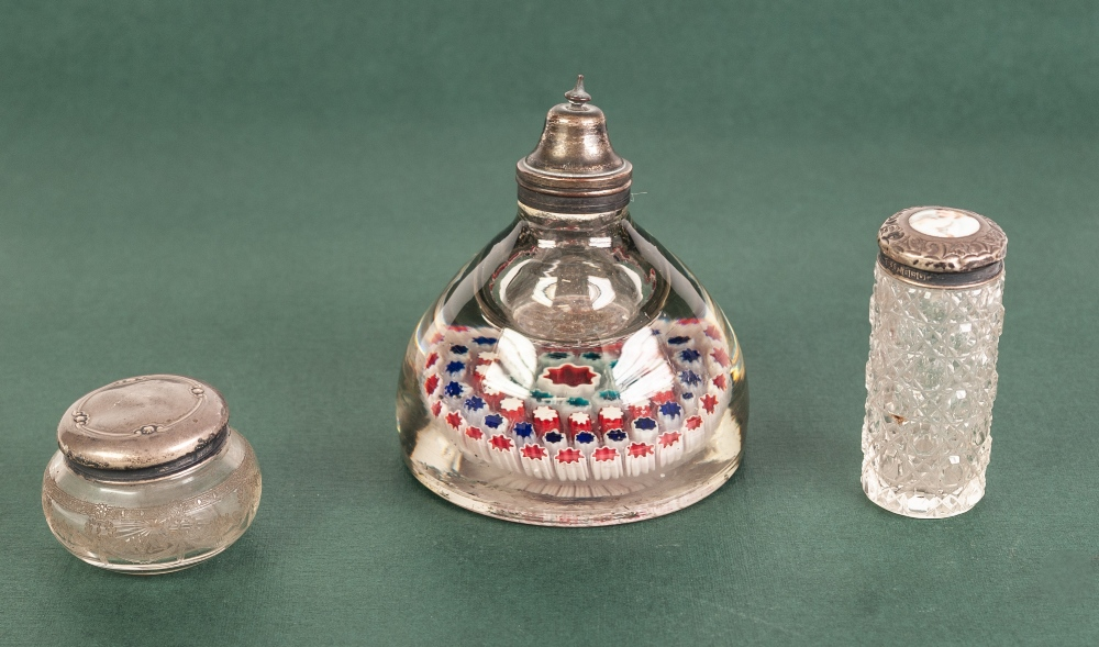 Lot 214 - A WHITE METAL TOPPED MILLEFIORI GLASS PAPERWEIGHT CUM INKWELL, also two silver topped dressing table