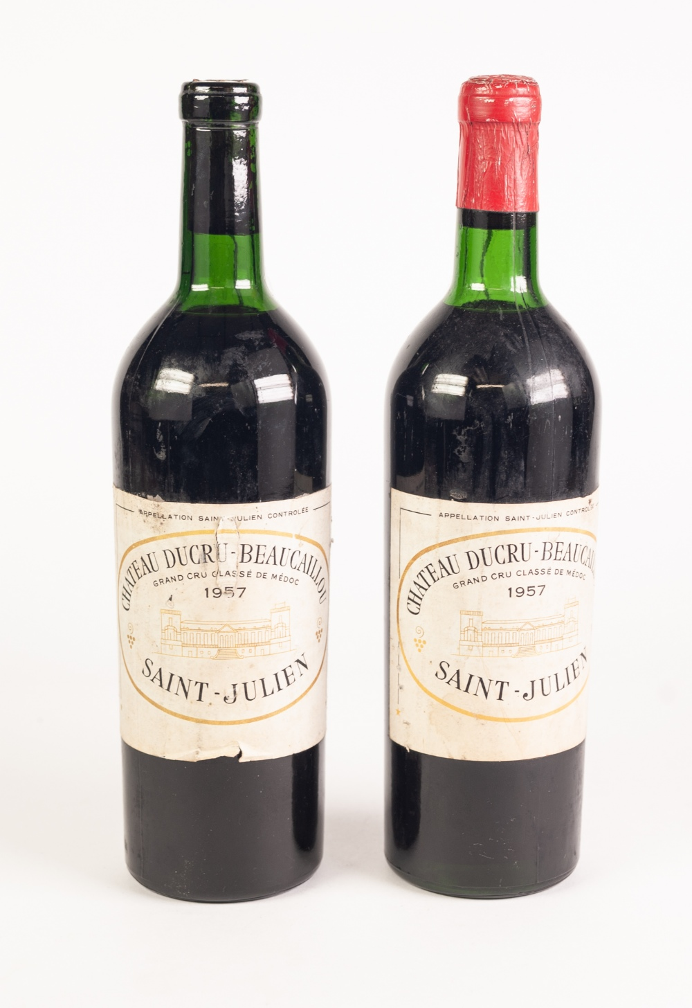 Lot 49 - TWO BOTTLES OF CHATEAU DUCRU-BEAUCAILLOU SAINT-JULIEN 1957 MEDOC RED WINE (one with red foil absent)