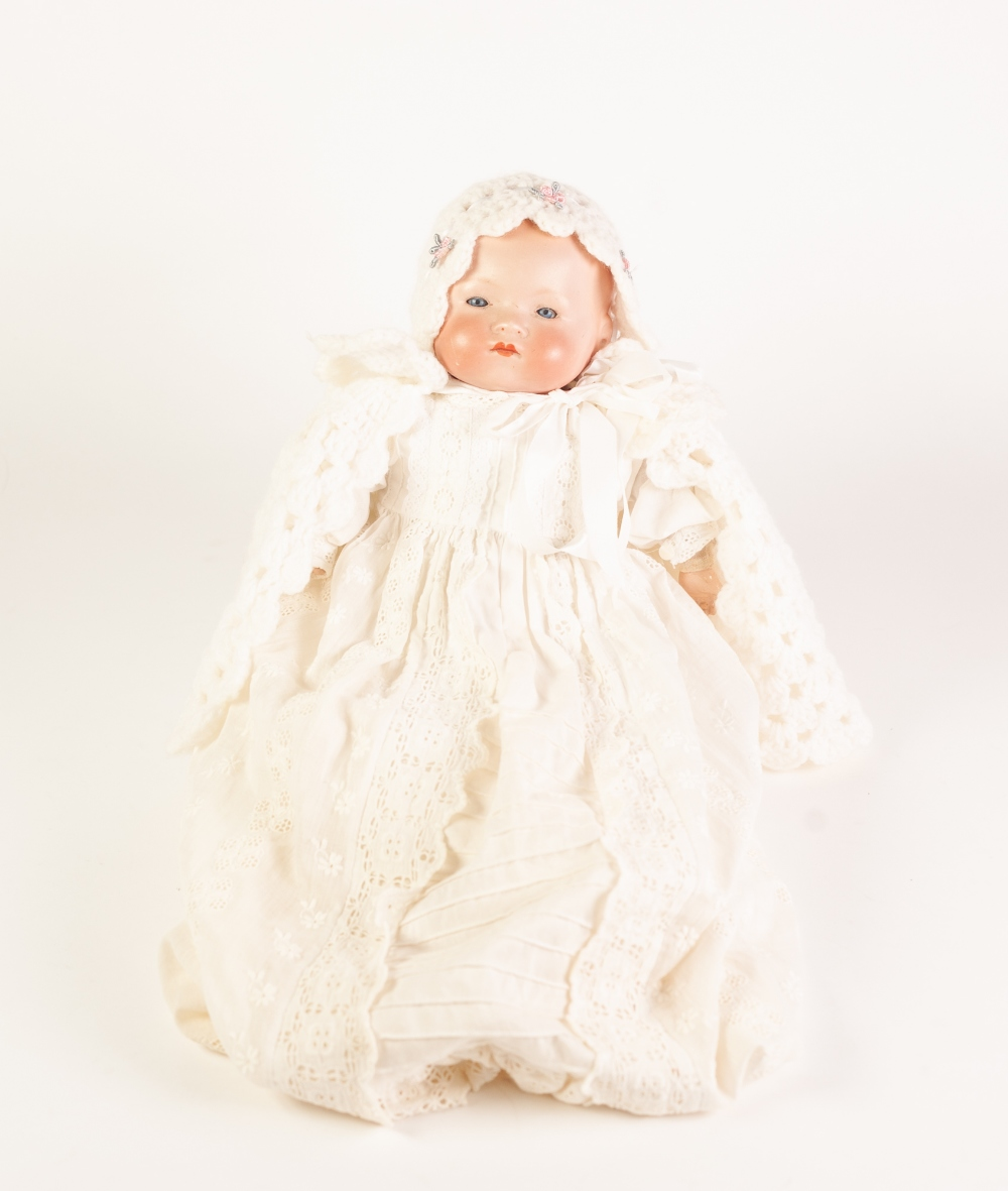 Lot 295 - A SMALL EARLY TWENTIETH CENTURY ARMAND MARSEILLE BISQUE HEAD BABY DOLL with sleeping blue eyes and