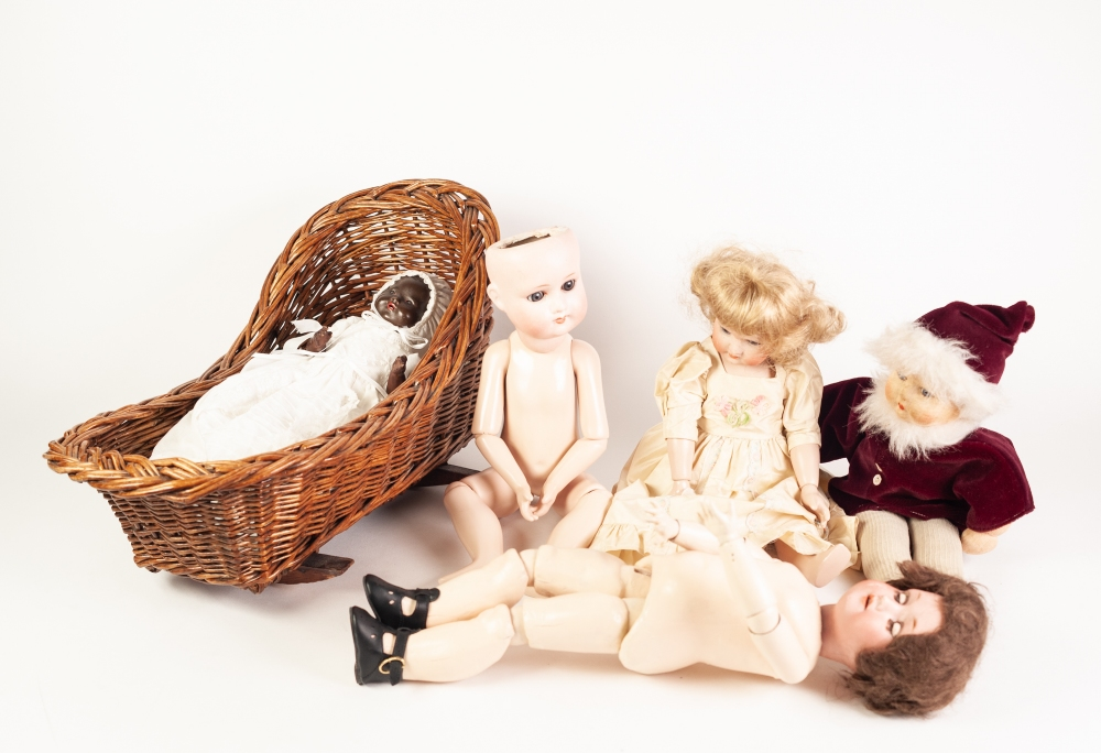 Lot 296 - A SMALL EARLY TWENTIETH CENTURY GERMAN BISQUE HEAD DOLL, impressed W and CO., 121 Am, with fixed