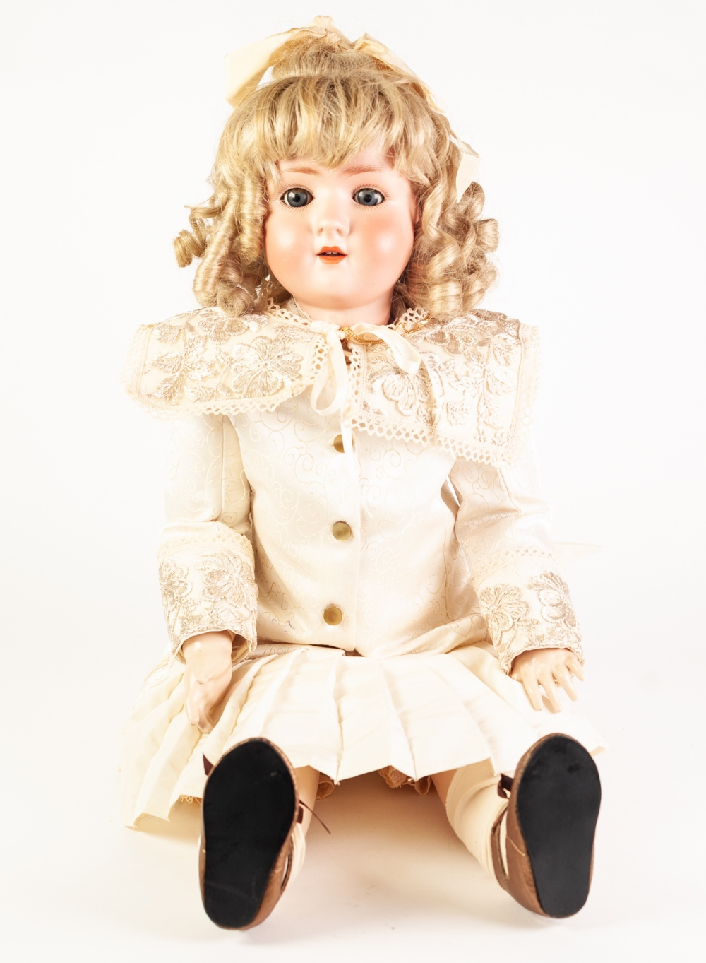 Lot 304 - AN EARLY TWENTIETH CENTURY SIMON AND HALBIG BISQUE HEAD DOLL with sleeping blue eyes and open mouth,