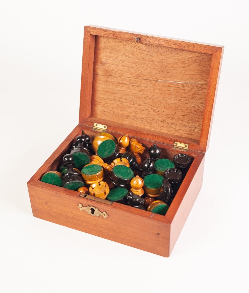 Lot 210 - MAHOGANY BOXED SET OF STAUNTON TYPE NATURAL AND EBONISED BOXWOOD WEIGHTED CHESS PIECES - 32 pieces