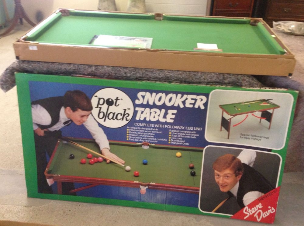 "A boxed Steve Davis 'Pot Black' junior snooker table. Includes a set of balls and cues.  54"" x"