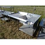 Custom built corner large single bowl sink unit with a small handbasin, tap sets, void under for