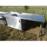 Stainless steel unit with a large single bowl sink and tap set, draining board, food preparation