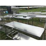 stainless steel table with two shelves over Shelf under with rack to the left hand side