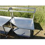 Mobile stainless steel food preparation station with a angled corner, sloped shelf for Gastronorm