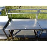 Stainless steel mobile food preparation station with a sloped shelf for Gastronorm pots and shelf