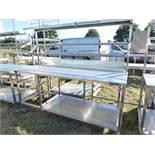Stainless steel mobile food preparation station with 1 shelf over, shelf under space for trays and a