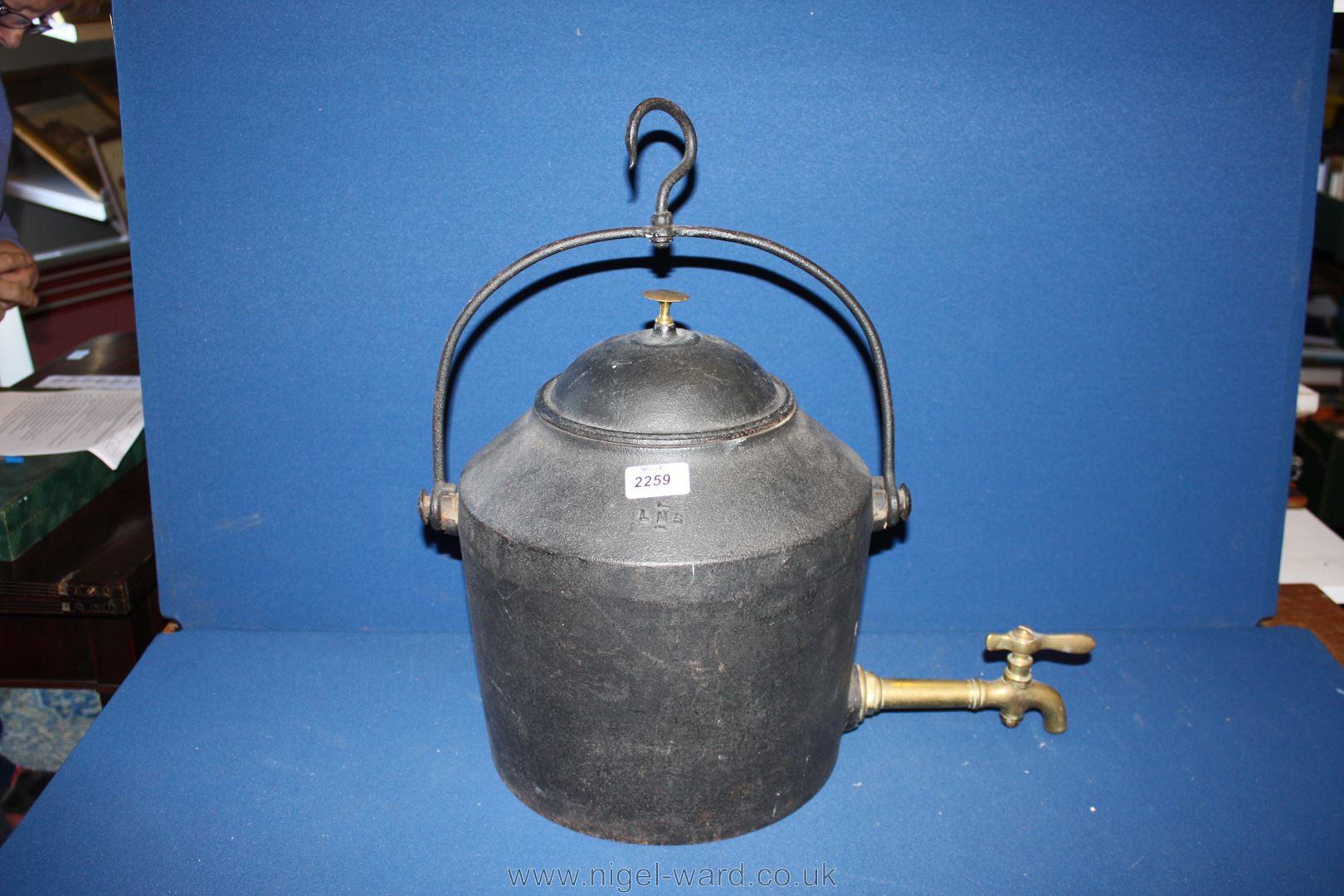A three gallon Cast Iron Kettle with brass spigot, cast iron handle ...