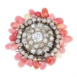 A DIAMOND AND CONCH PEARL RING comprising of concentric rows of round old cut diamonds, within a