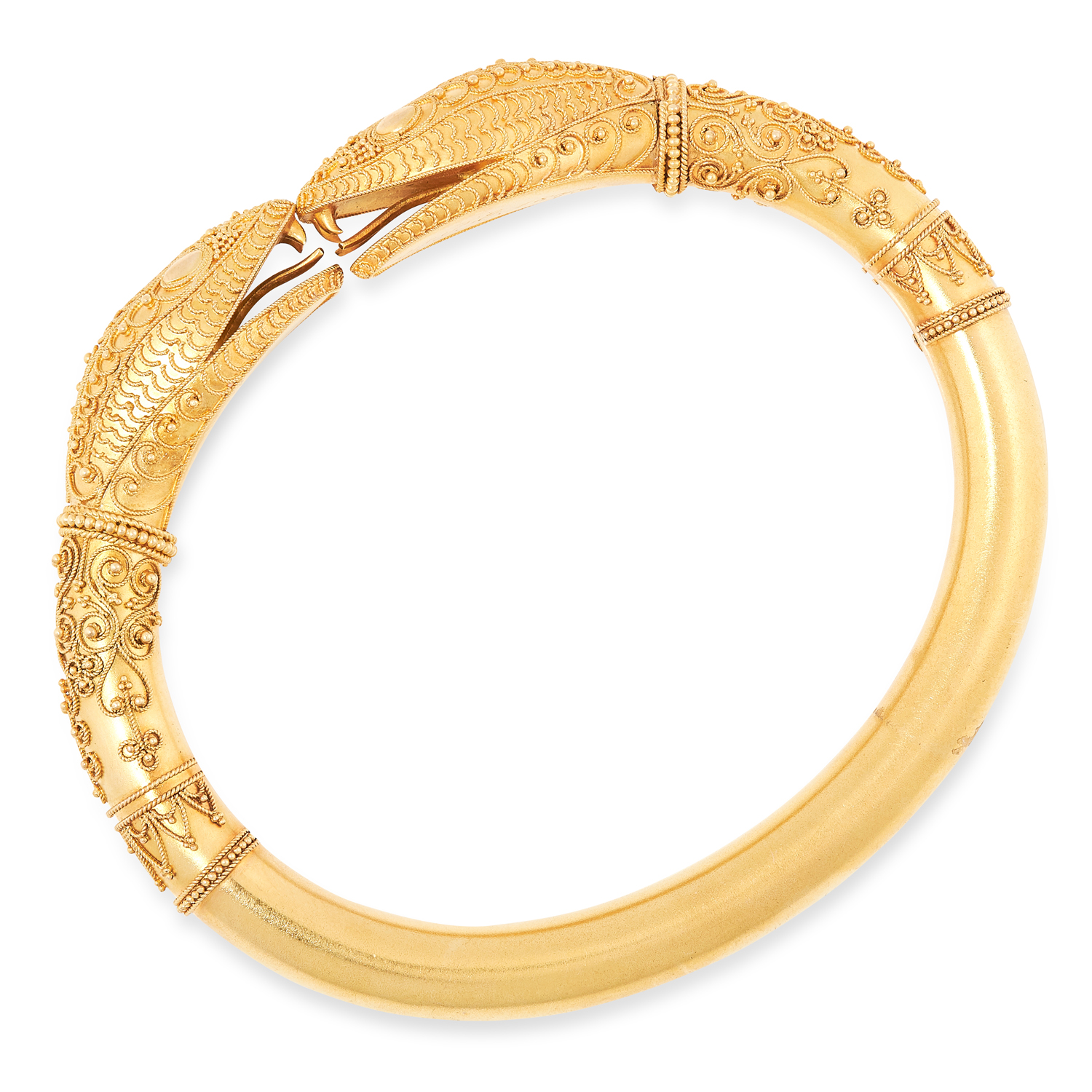 AN ANTIQUE DOUBLE SNAKE HEAD BANGLE, CIRCA 1879 in high carat yellow gold, the body designed as a - Image 2 of 2