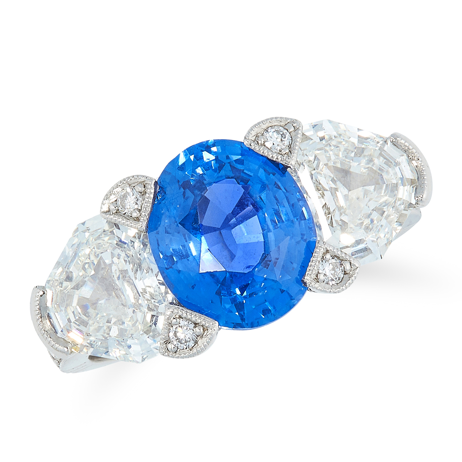 A CEYLON NO HEAT SAPPHIRE AND DIAMOND THREE STONE RING set with an oval cut sapphire of 3.80