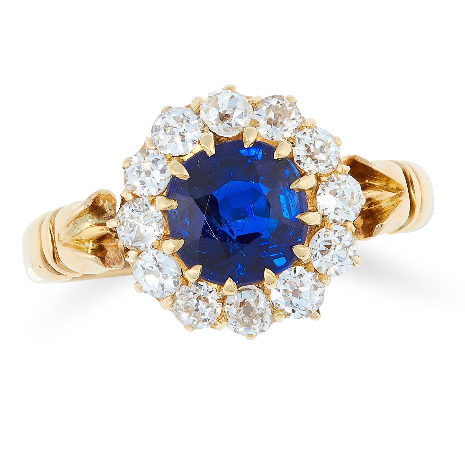 AN ANTIQUE SAPPHIRE AND DIAMOND CLUSTER RING, 1903 in 18ct yellow gold, set with a cushion cut