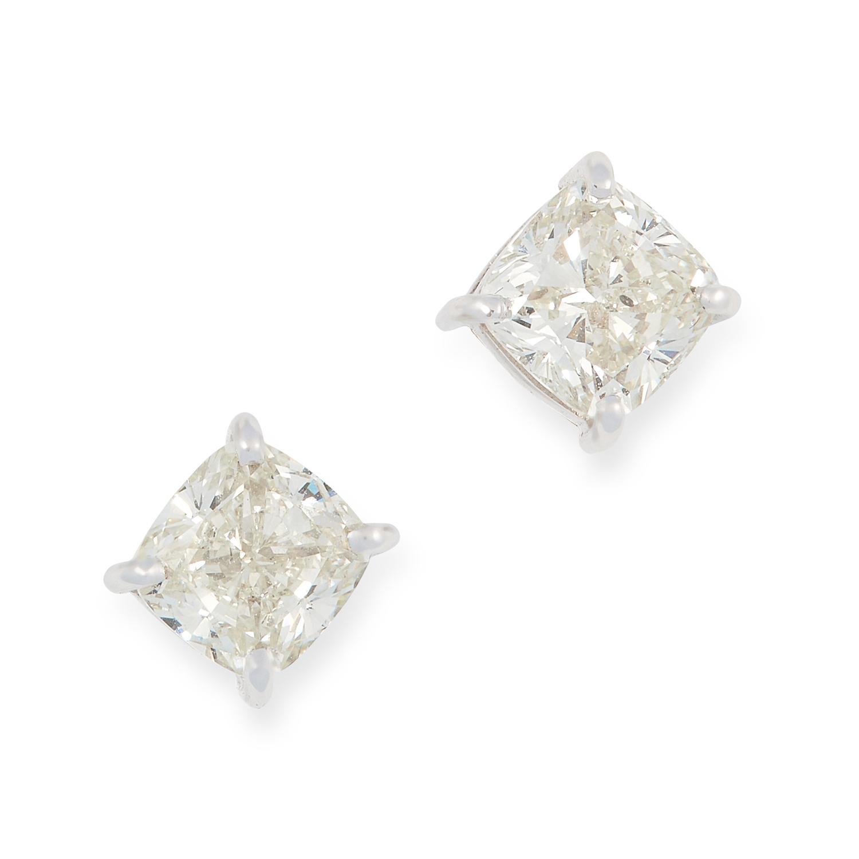 A PAIR OF 1.85 CARAT DIAMOND STUD EARRINGS set with square cushion cut diamonds, 0.5cm, 2.7g.