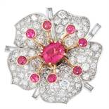 A RUBY, RUBELLITE AND DIAMOND FLOWER RING, 1960s set with a central cushion cut rubellite of 2.60