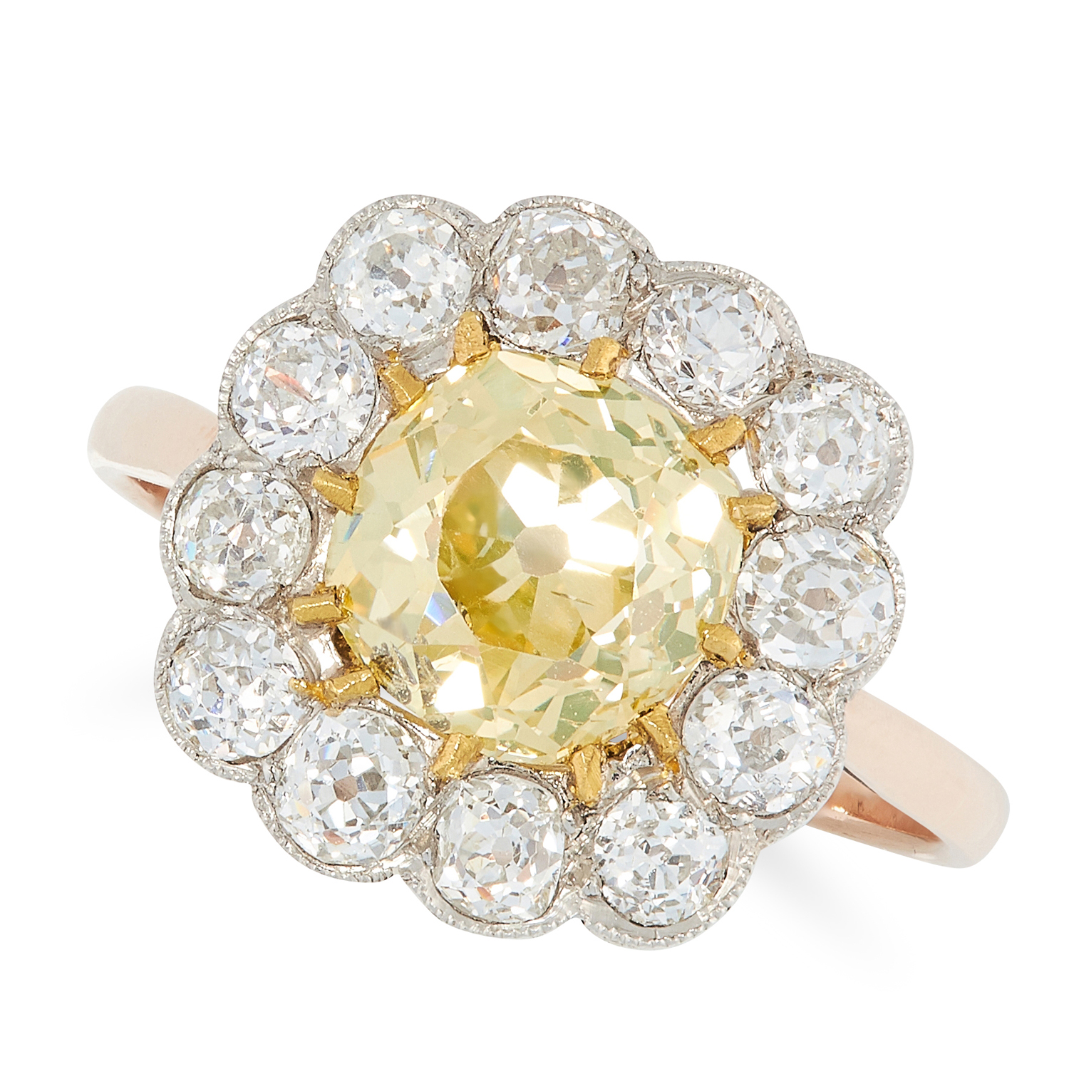 A FANCY YELLOW DIAMOND CLUSTER RING in yellow gold, set with an old cut fancy yellow diamond of