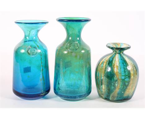 Three Mdina glass vases, two in the sea sand pattern with a Maltese cross; another crystal blue stripe vase, etched Mdina to