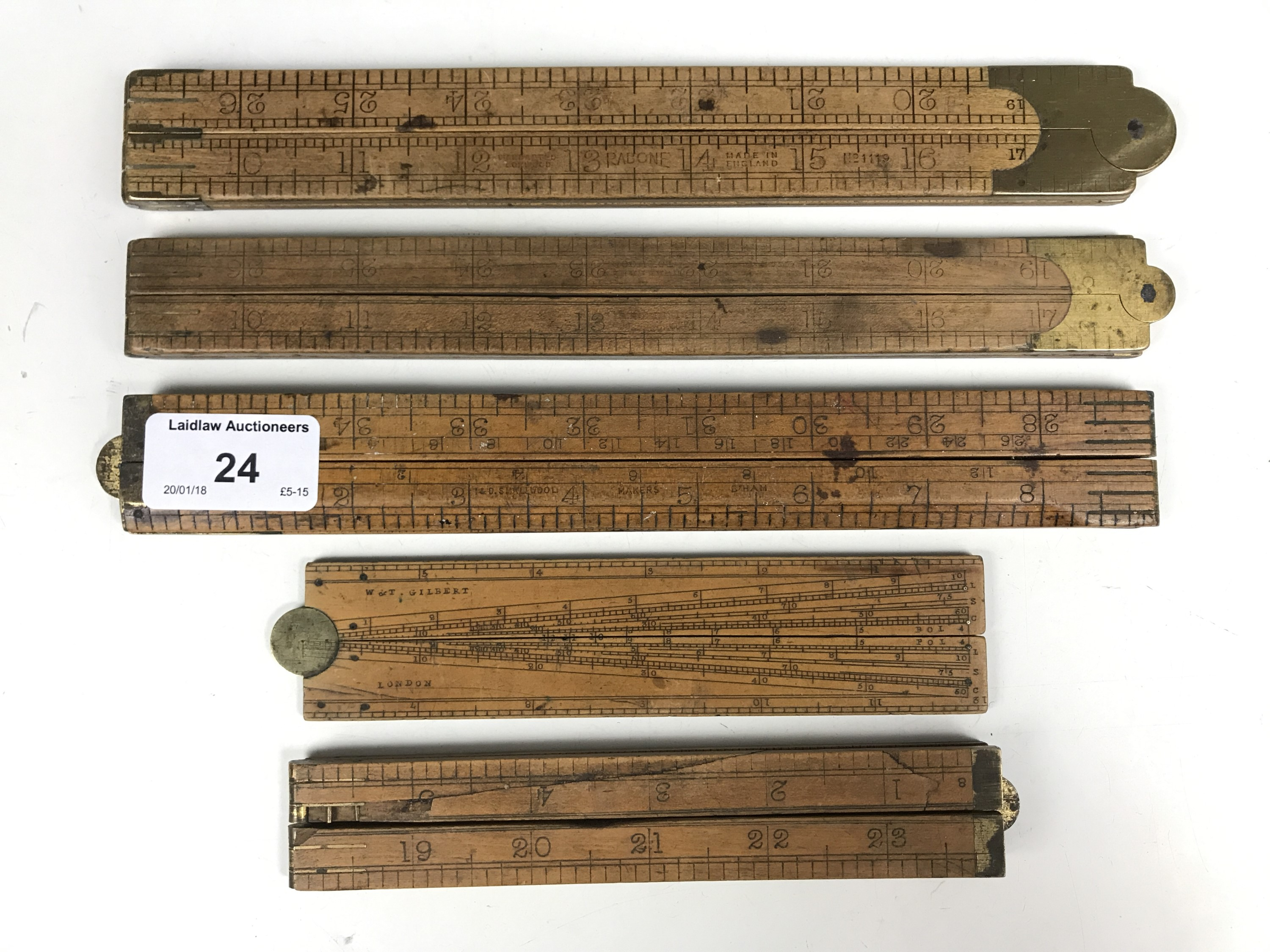 Lot 24 - A 19th Century Gunter's rule together with vintage folding rulers