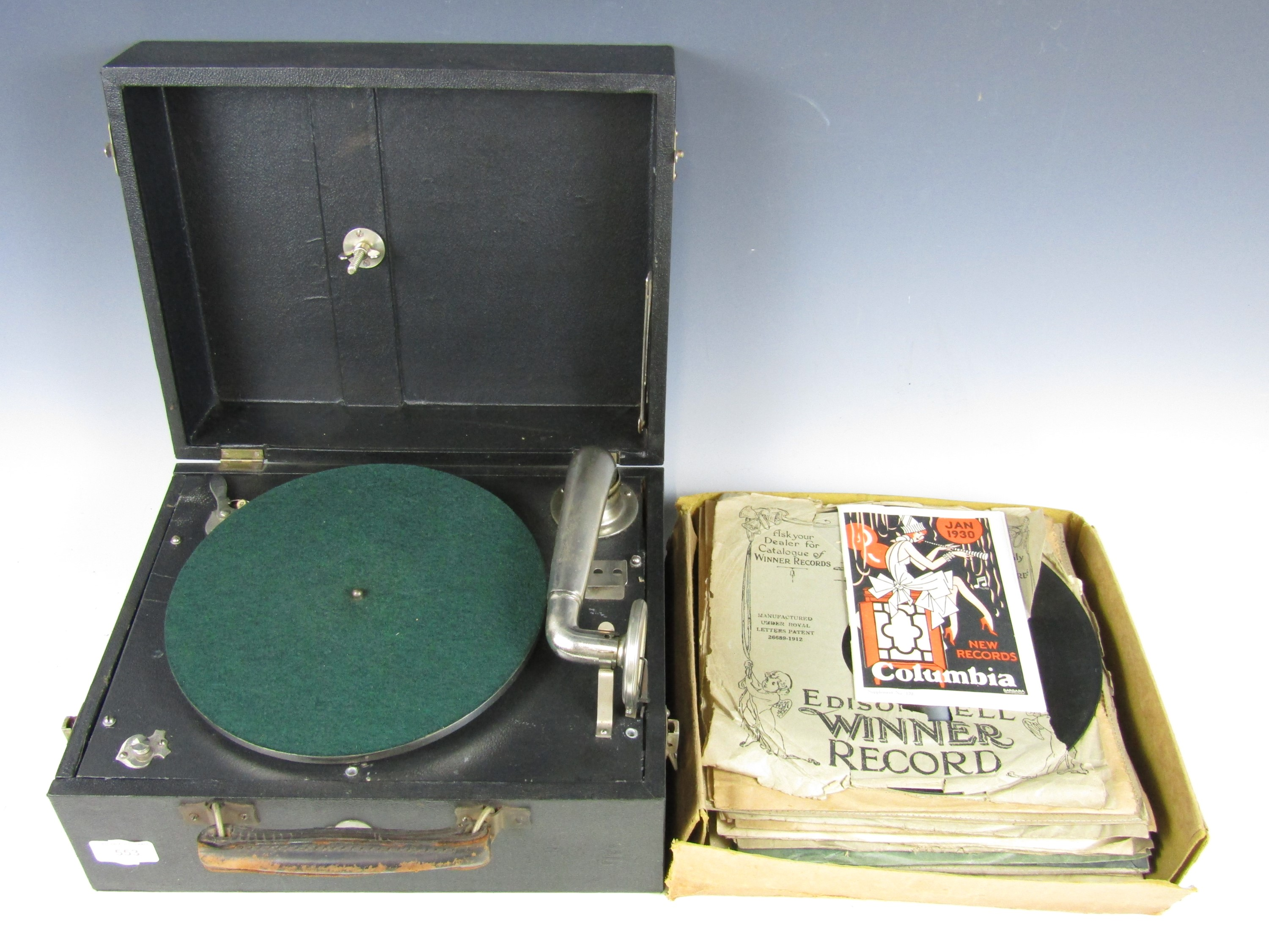 Lot 36 - A portable gramophone with records