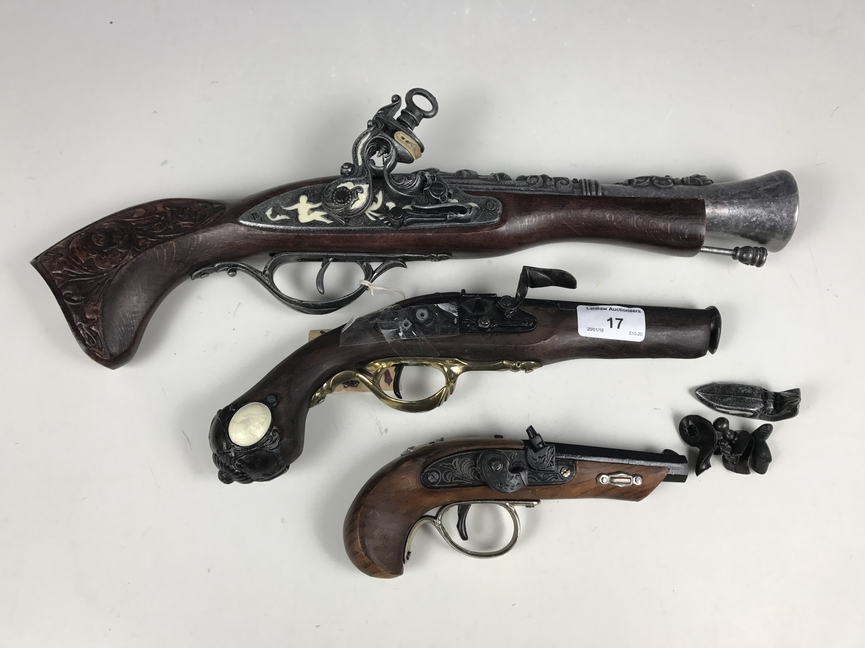 Lot 17 - Three replica antique guns