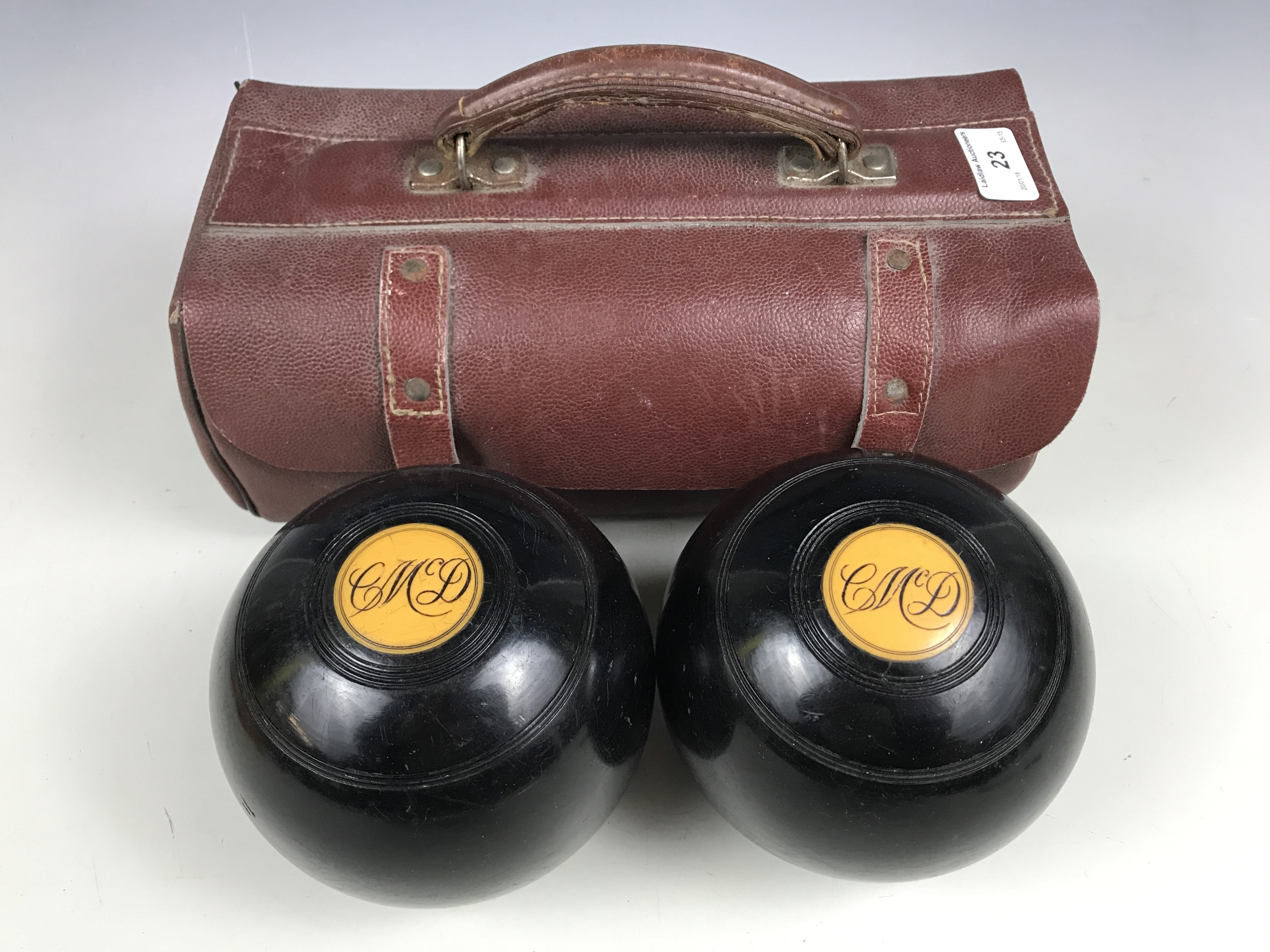 Lot 23 - A cased pair of bowling woods