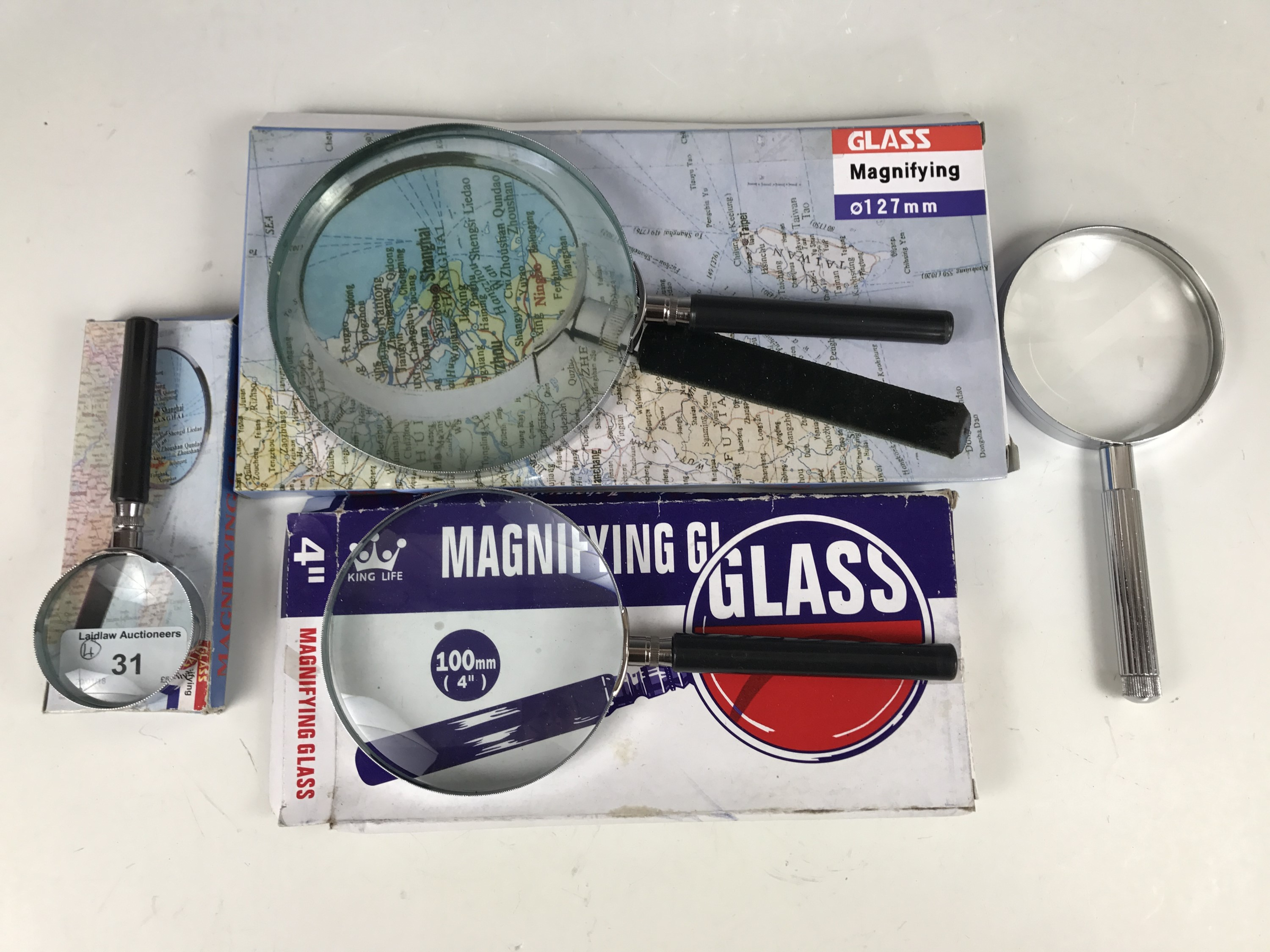 Lot 31 - Four magnifying glasses
