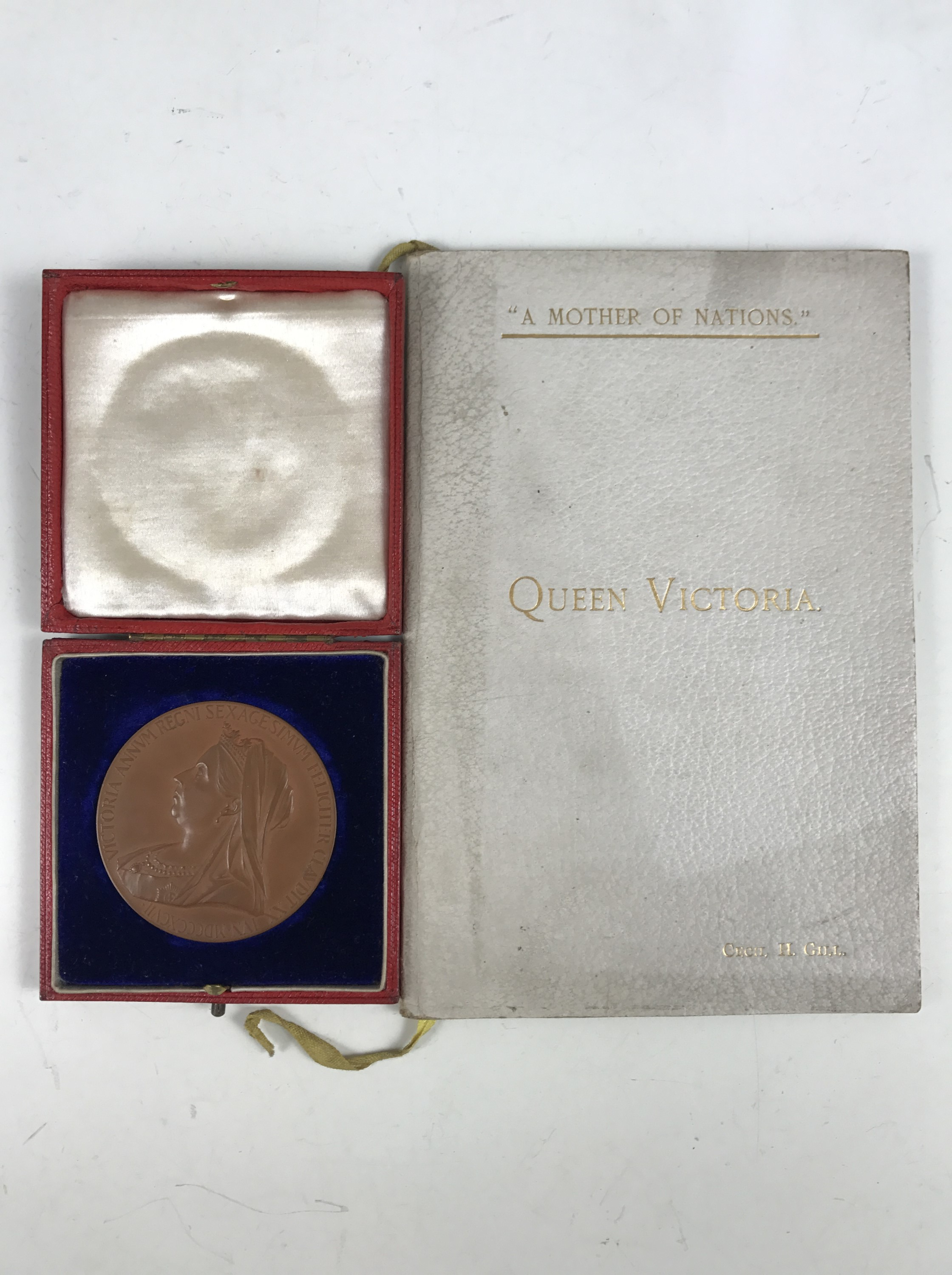 Lot 1 - A Queen Victoria diamond jubilee medallion together with a privately published 1901 Bucklebury Queen