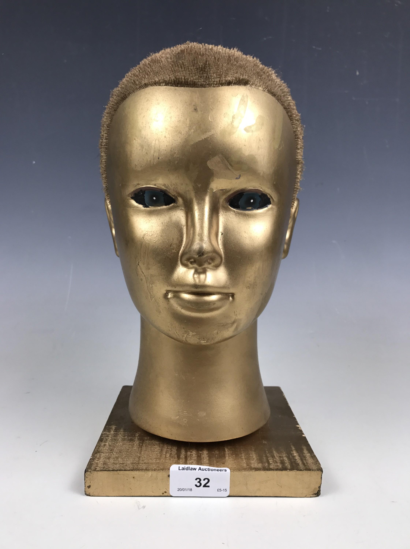 Lot 32 - A gilt mannequin head
