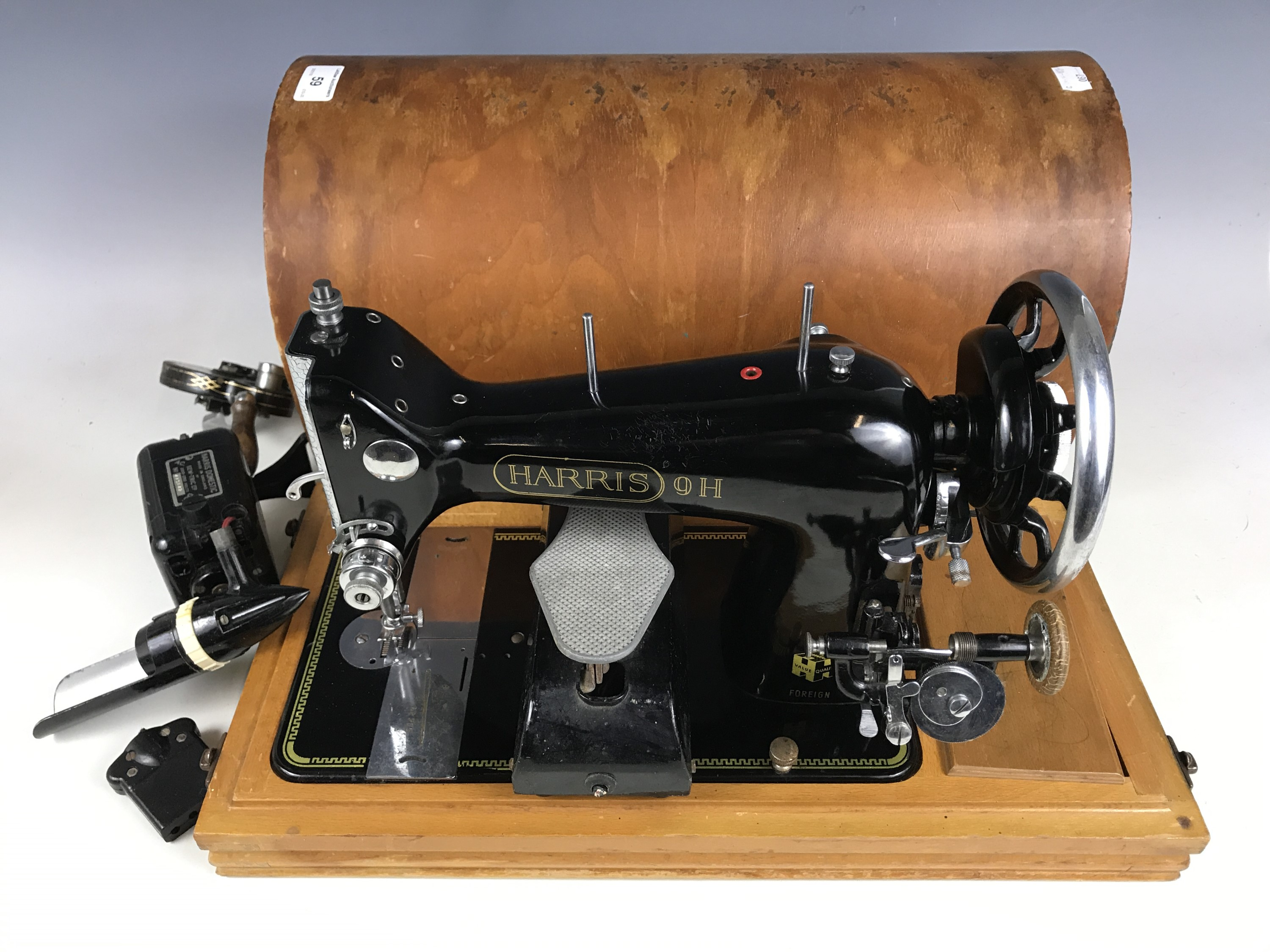 Lot 59 - A Harris 9H sewing machine with accessories