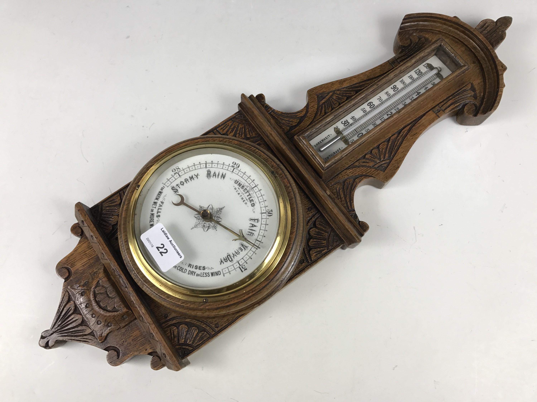 Lot 22 - A Victorian carved oak banjo barometer