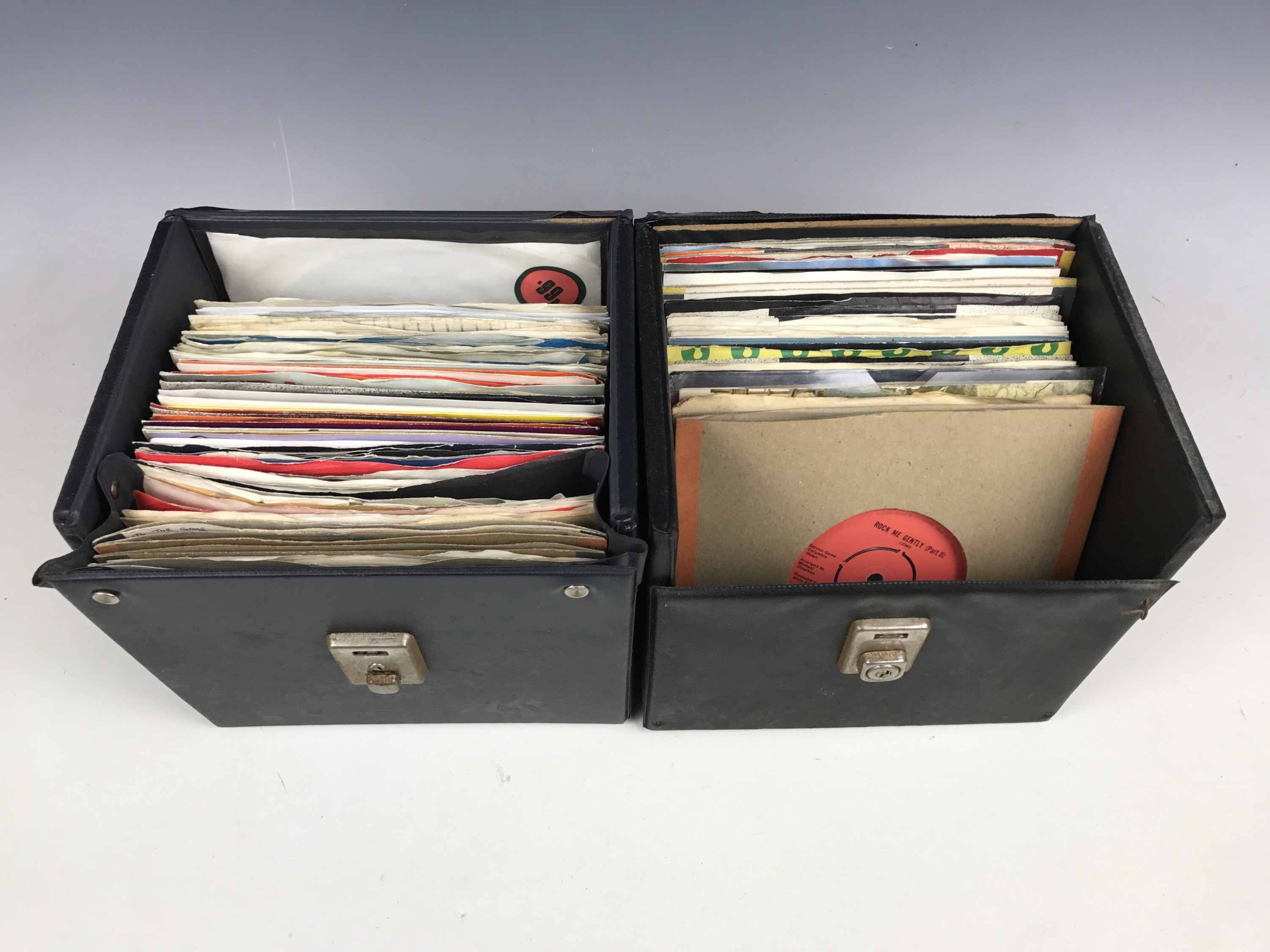 Lot 53 - Two single record cases with quantity of records