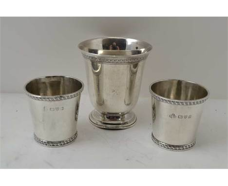 JAY RICHARD ATTENBOROUGH CO. LTD A PAIR OF FLARED SILVER TOTS, Chester 1916, combined weight; 65g, together with a small plat
