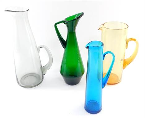 A Whitefriars grey glass water jug, 31cm high., an amber glass jug, 24.5cm high., green glass jug, 29.5cm high., and a turquo