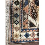 A MIDDLE EASTERN FRINGED CARPET