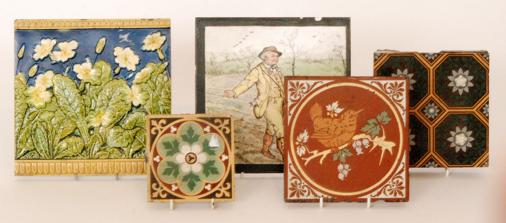 Lot 18 - Five assorted late 19th Century tiles comprising a Minton 8 inch dust pressed tile decorated with a