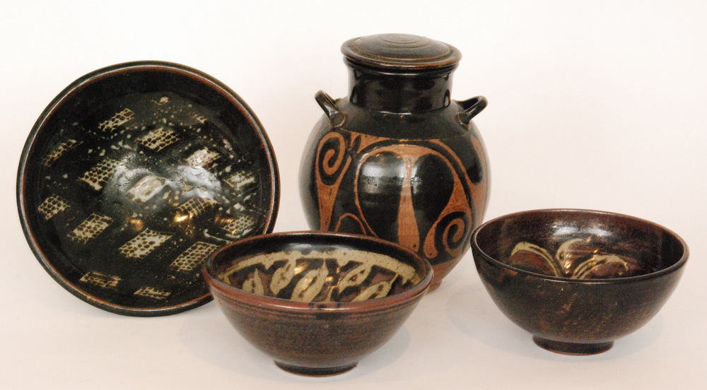 Lot 41 - A studio pottery lidded vessel decorated in an all over black glaze with wax resist decoration to